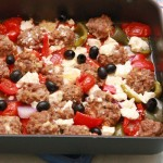 Lamb meatballs with roast vegetables, olives and feta
