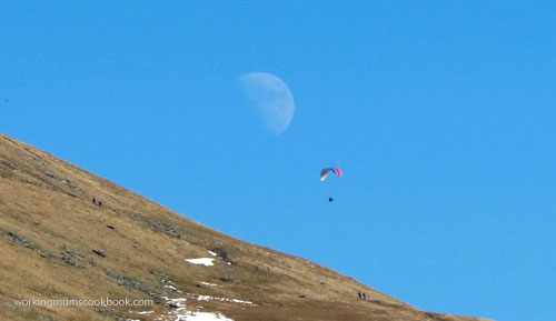 Paragliding in the moon-and-sun-light