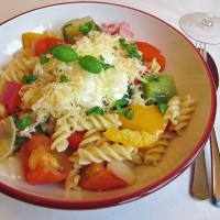 Roast vegetables with creamy pasta, cheese and salad
